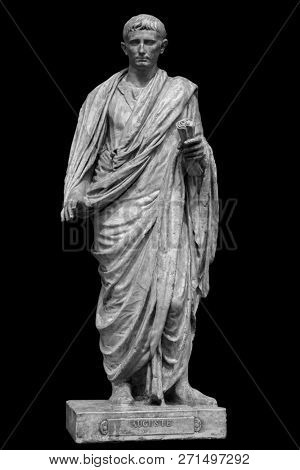 Caesar Octavianus Augustus roman emperor adopted son of Julius Caesar. Isolated statue on black