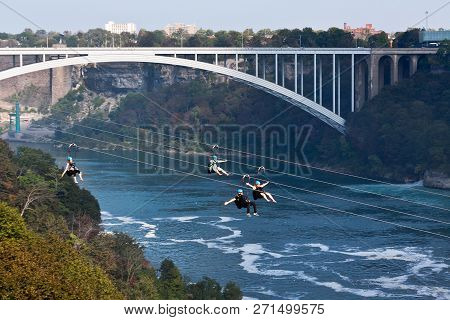 Niagara Falls, Ontario, September 24, 2017 - Horizontal Of Revelers Riding The Zip Line Attraction W