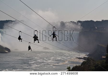 Niagara Falls, Ontario, September 24, 2017 - Horizontal Of Revelers Riding The Zip Line Attraction A