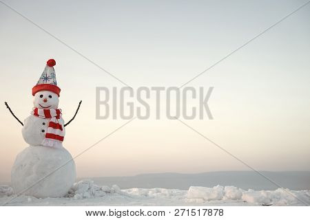 Xmas Or Christmas Decoration. New Year Snowman From Snow In Hat. Christmas Party, Winter. Happy Holi