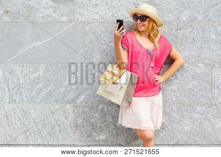 Beautiful Woman Doing Selfie With Shopping Bags
