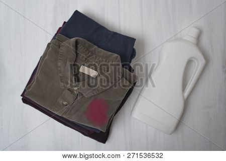 Stack Foldable Dirty Linen And A Bottle Of Liquid For Washing. Top View