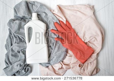Clothes, Rubber Glove And Bottle With Detergent. Top View