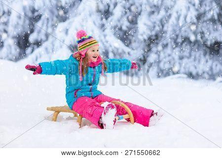 Girl On Sleigh Ride. Child Sledding. Kid On Sledge