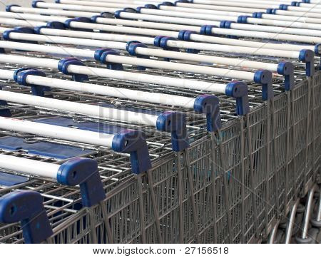 Row of parked trolleys in supermarket