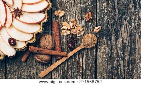 Apple Pie Tart. Homemade Apple Pie On Rustic Wooden Background. Ingredients - Apples, Nuts, Cinnamon