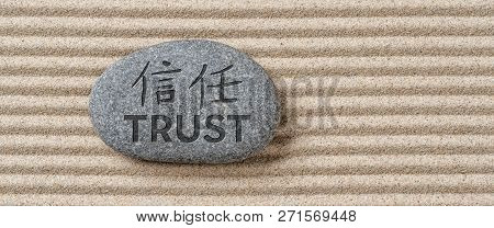 Stone On Sand With The Inscription Trust