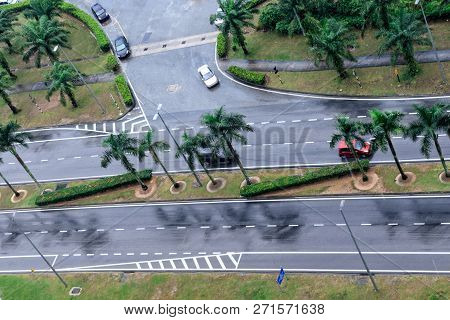 Cars Drive On Wet Road. Raining Streets, Rainy Day. Wet Asphalt, Aerial View. Malaysia.