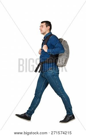 Side View Full Length Portrait Of Confident Young Man Carrying A Backpack Walking, Human Action Step