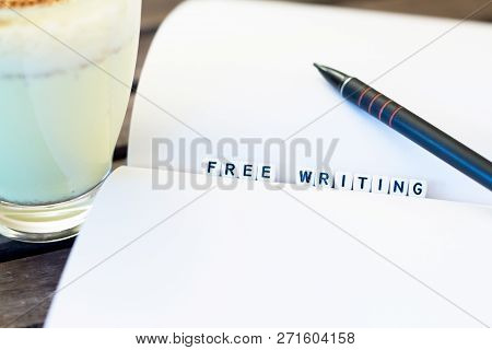 Notebook And Pensil On Table With White Letters Free Writing On Dark Brown Wooden Background. Concep