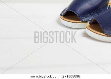 Summer Blue Sandals With White Sole On White Woooden Background. Right Side View, Place For Text, Co