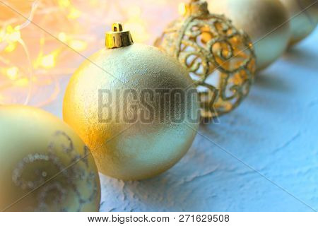 Beautiful Christmas Card, New Year. Golden Christmas Background. The Golden Decoration Christmas Bal