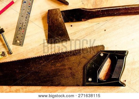 Try Square And Wood Pencil And Saw And Axe And  Tape Measure  For Carpenter On Wooden Background Too