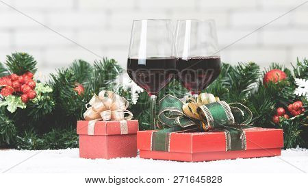 Two Red Wine Glasses Set Next To Red Gift Boxex On Snowy Table Prepare For Celabraion, Decorate With