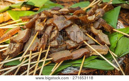 Satay Sate Skin Cow With Brown Color And Banana Leaf To Serve From Indonesia Traditional Food