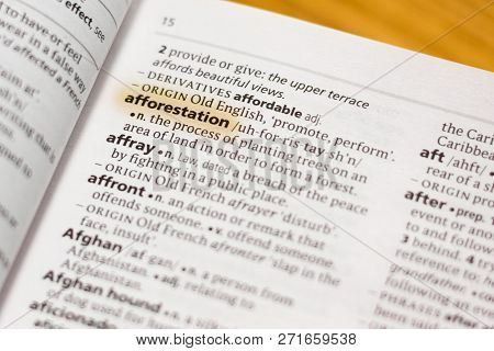 The Word Or Phrase Afforestation In A Dictionary Highlighted With Marker.