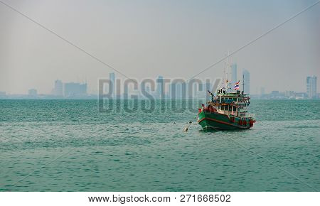 Colorful Traditional Thai Fishing Boat With The City Of Pattaya In The Background Thailand