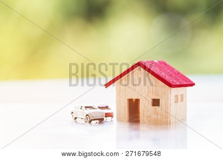 Saving Or Real Estate Investment Concept :wooden House And Cars With Light Background For Dreaming E