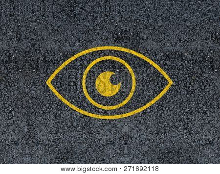 Eye Icon Drawn With Paint On Road Asphalt.