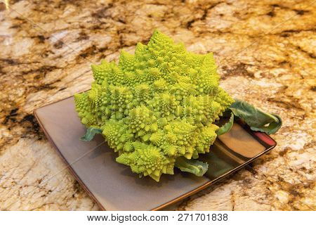 Bright Green And Yellow Romanesco Broccoli On A Plate.