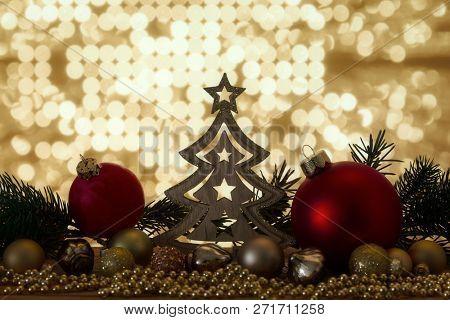 A Christmas symbols decoration red glass balls and bokeh lights