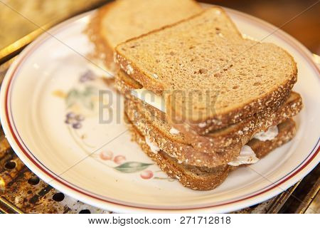 Stacks Of Sandwiches With Whole Wheat Bread, White Cheese, And Chicken On A Ceramic Plate.