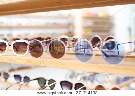 Sunglasses, A Fashionable Addition To Styling. Shelf With Over-sun Glasses In A Clothing Store.