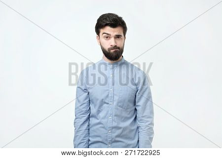 Doubtful Bearded Young Spanish Man Looking With Mistrust.