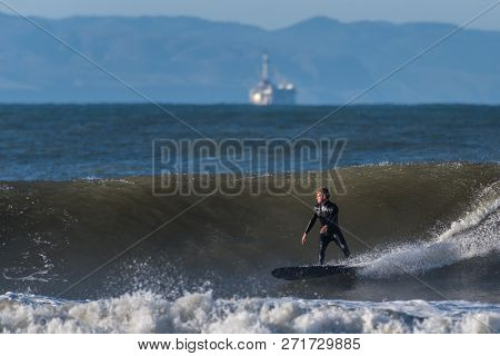 Goofy Foot Surfer Drops Into A Nice Set Wave During Last Of Northwest Swell In Ventura, California,