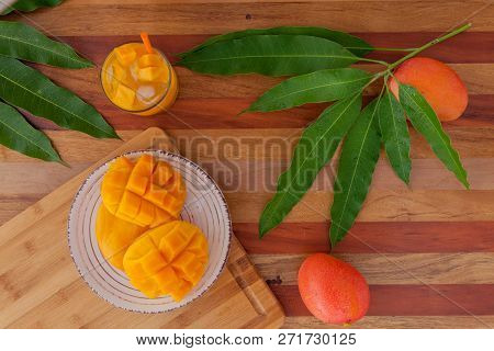 Mango Fruit And Mango Drink On The Wooden Cutting Board. Tropical Fruit.