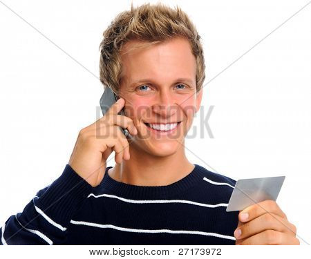 Handsome caucasian man makes a phone call regarding his credit card payments with a mobile phone