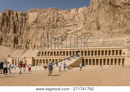 Tourists In Front Of The Deir Al-bahari Complex  And The Temple Of Hatshepsut, Luxor, Egypt, October