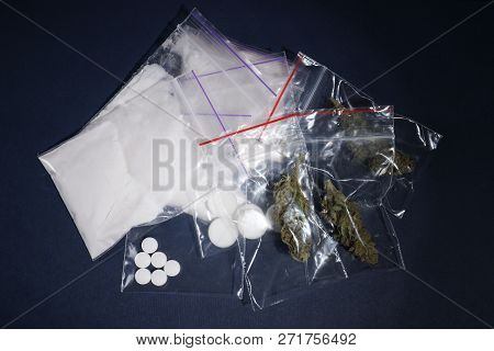 Cocaine, dried hemp and ecstasy on dark background, top view poster