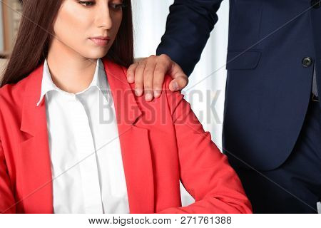 Boss Molesting His Female Secretary In Office, Closeup. Sexual Harassment At Work