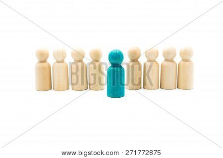 Wooden Figures In Line As Business Team, With One Blue Figure Standing Out From The Crowd