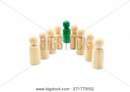 Green Figure Leading Group Of Wooden Figures In Spearhead Formation