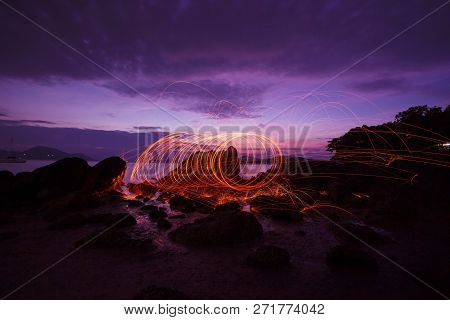 Swing Fire Swirl Steel Wool Light Photography Over The Stone With Reflex In The Water Beautiful Ligh