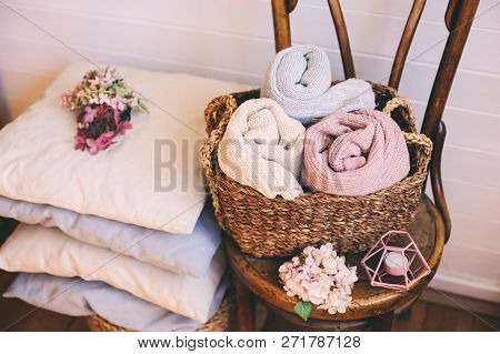Cozy Interior Details, Scandinavian Lifestyle. Organizing Clothes In Wicker Backets, Seasonal Wardro