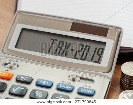 Tax Word And 2019 Number On Calculator. Business And Tax Concept. Pay Tax In 2019 Years.