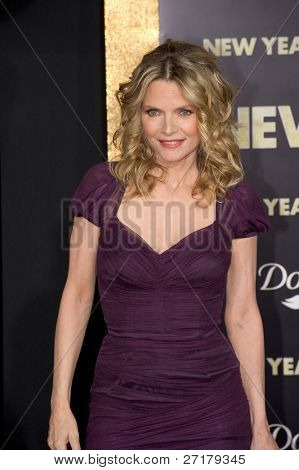 """HOLLYWOOD, CA - DECEMBER 5: Actress Michelle Pfeiffer arrives at the premiere of """"New Year's Eve"""" at Grauman's Chinese Theater on December 5, 2011 in Hollywood, California"""