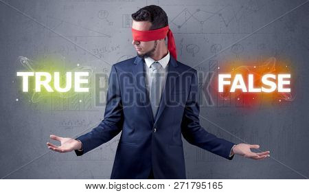 Businessman with red ribbon on his eye deciding true or false