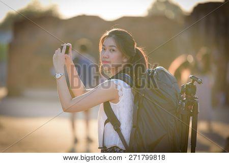 Asian Beautiful Girl Has Travel And Take A Photo At Wat Chaiwatthanaram Temple In Ayuthaya, Thailand