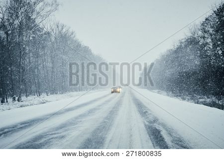 Car In Storm On A Winter Road With Traffic.  Danger Driving In Winter. First Person View