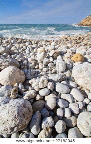 Stony beach in Espichel Cape, Portugal