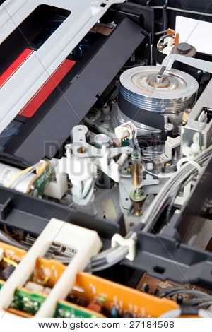 Interior of a VCR with a cassette inserted and playing