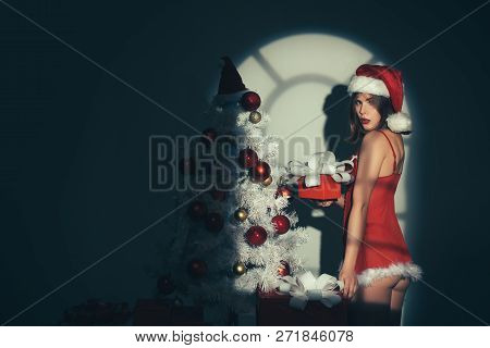Night Time. Winter Holidays And People Concept. Beautiful Sexy Girl With Christmas Gifts. Woman In A