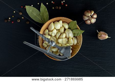 Fresh Garlic Heads, Cloves Set In Plate On A Black Stone Surface, Top View, Copy Space, Free Space F