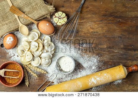 Raw Homemade Delicious Traditional Italian Ravioli, Dumplings With Meat On Dark Wooden Old Surface,