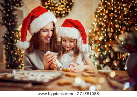 Merry Christmas And Happy Holidays. Family Preparation Holiday Food. Mother And Daughter Cooking Chr