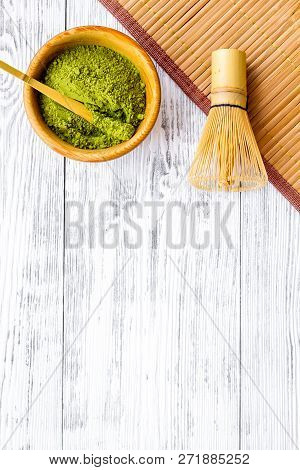 Japanese Matcha Tea Tradition. Matcha Accesories, Whisk Near Matcha Powder In Bowl On White Wooden B